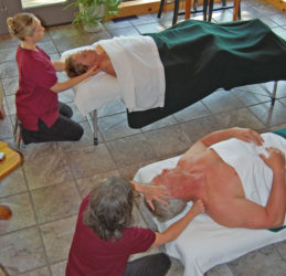 A relaxing couples massage is given by our professional masseuses inside a cabin.