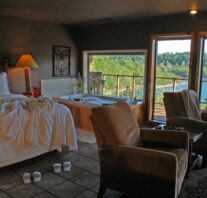 Robes, slippers, champagne and a bubbling Jacuzzi await overlooking Beaver Lake through the large picture window built flush with the rim of the spa tub.
