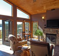The view, fire place, and entertainment center as seen from the interior of one of our cabins on a sunny day.
