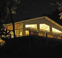 The Bluff Cabin as seen from below on a clear starry night.