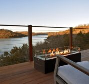 The mile long view of Beaver Lake and the Ozark Mountains as seen from one of the suspended decks with fire table and comfortable rockers available in the Sky Suites.