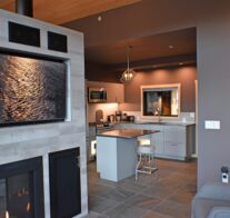 The textured, gray porcelain entertainment center with a 55