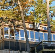 The hot tub lodge is perched in the trees overlooking Beaver Lake