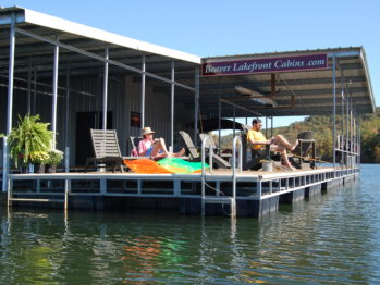 Two people relax on the floating deck on Beaver Lake.