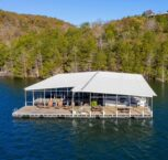 A morning aerial view of the floating sundeck and covered picnic area on the lake side end of our dock where you can relax or fish all day.