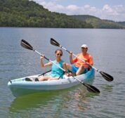 Two guests out on the lake in our complimentary, tandem sit-on-top kayaks.