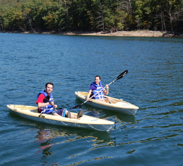 Two guests on solo kayaks on Beaver Lake provided complimentary to all registered guests.
