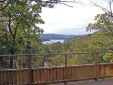 Beaver Lake as seen framed by trees from the front deck of the Bluff Cabin which has the highest elevation of all the units on the resort.