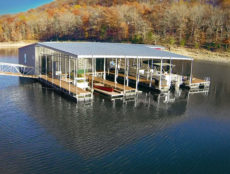 A morning aerial view of the complimenary non motorized boats and covered rental slips on the shore side of our dock where you can enjoy all the fun lake activities.